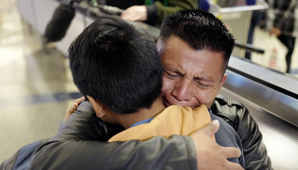 David Xol-Cholom of Guatemala hugs his son, Byron, at Los Angeles International Airport as they reunite Jan. 20, 2020, after being separated during the Trump administration's wide-scale separation of immigrant families. (AP)