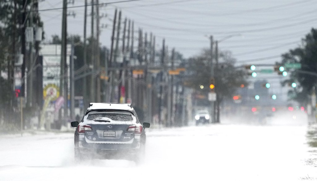 Vehicles drive on snow and sleet covered roads Feb. 15, 2021, in Spring, Texas. (AP)