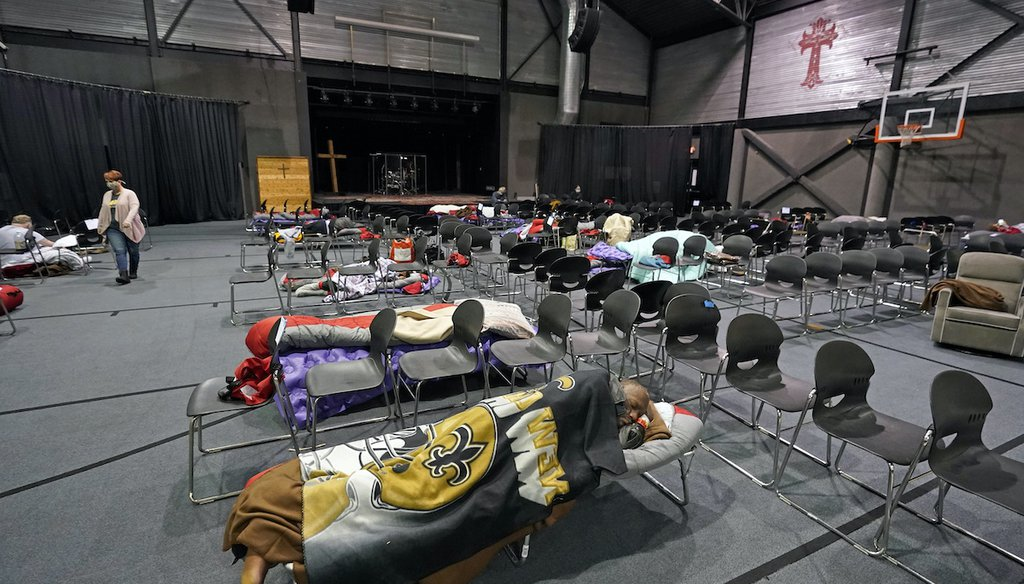 People seeking shelter from below freezing temperatures rest inside a church warming center Feb. 16, 2021, in Houston. (AP)
