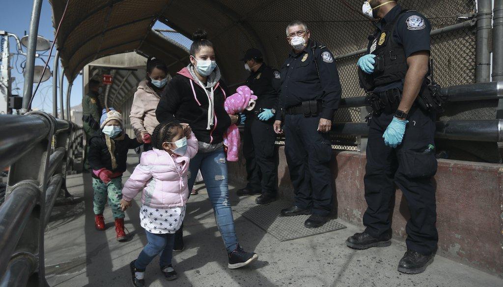 A migrant family crosses the border into El Paso, Texas, in Ciudad Juarez, Mexico, on Feb. 26, 2021. (AP)