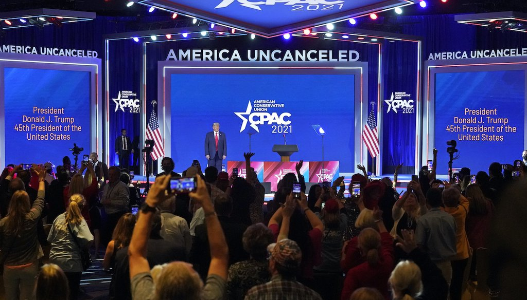 Supporters cheer and wave as former president Donald Trump is introduced at the Conservative Political Action Conference, Feb. 28, 2021, in Orlando, Fla. (AP)