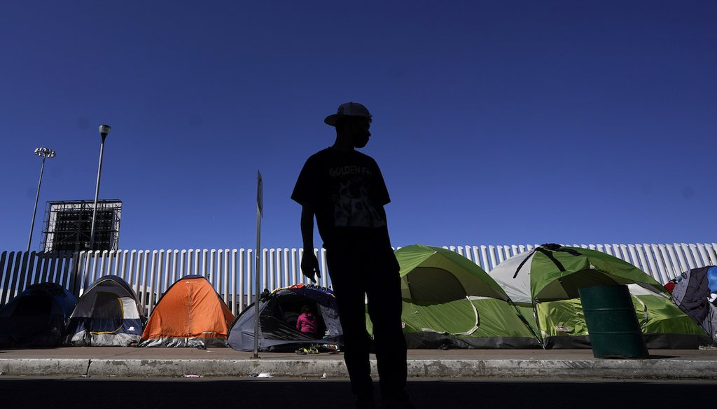 A migrant from Honduras seeking asylum in the U.S. stands in front of tents at the border crossing on March 1, 2021, in Tijuana, Mexico. (AP/Bull)