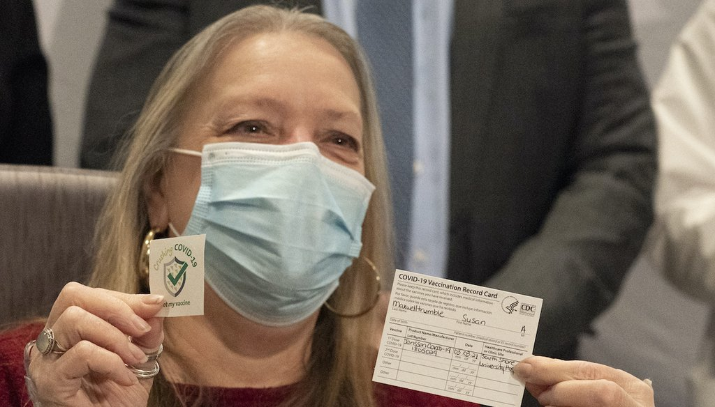Susan Maxwell Trumble displays her vaccination card after being inoculated with the Johnson & Johnson COVID-19 vaccine at South Shore University Hospital, March 3, 2021, in Bay Shore, N.Y. (AP)