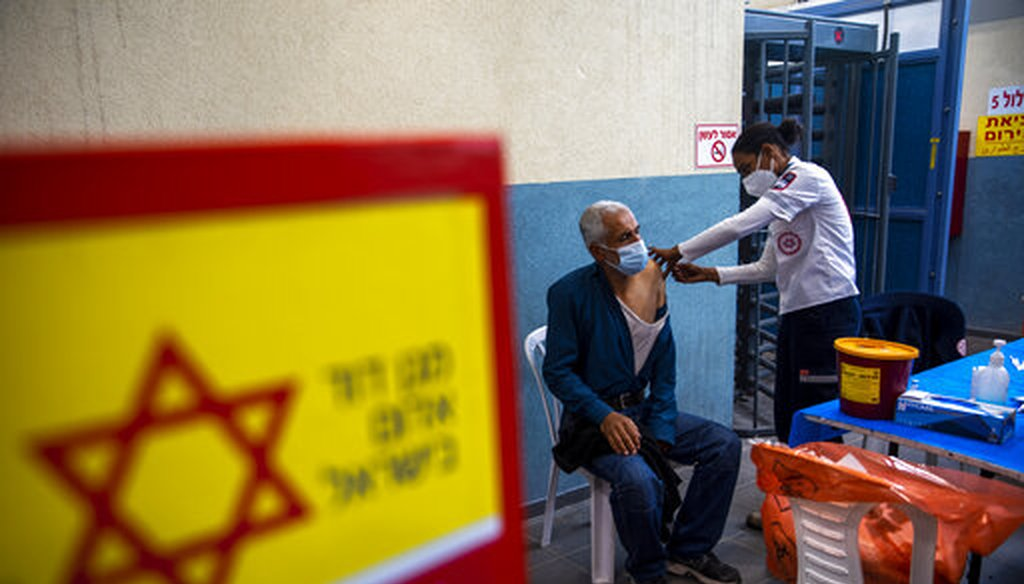 A Palestinian laborer who works in Israel receives his first dose of the Moderna COVID-19 vaccine at a vaccination center at the Meitar checkpoint between Israel and the West Bank on March 8, 2021. (AP)