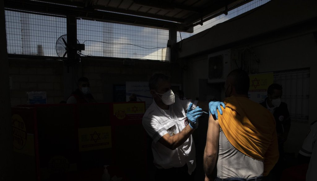 A Palestinian who works in Israel receives a Moderna COVID-19 vaccine at the Tarkumiya crossing between the West Bank and Israel, Monday, March 8, 2021. (AP)