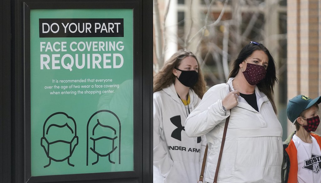 A sign requiring face masks is seen at City Creek Center, March 8, 2021, in Salt Lake City.  (AP)