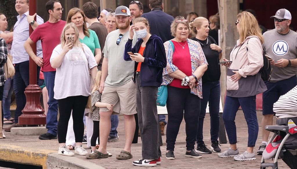 Spectators wait to watch a cattle drive demonstration at the Fort Worth Stockyards Thursday, March 11, 2021, in Fort Worth, Texas. Gov. Greg Abbott allowed the state mandates for COVID-19 safety measures to expire so people can forgo masks. (AP)