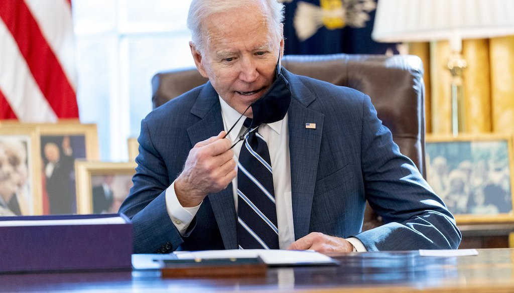 President Joe Biden sits down to sign the American Rescue Plan, a coronavirus relief package, in the Oval Office of the White House, on March 11, 2021. (AP)