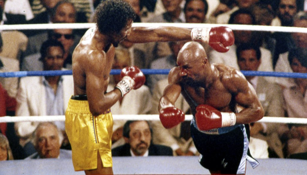 """Boxers Thomas """"Hitman"""" Hearns (left) and Marvelous Marvin Hagler fought outdoors at Caesars Palace in Las Vegas on April 15, 1985, for Hagler's middleweight title. Hagler won by technical knockout. He died at age 66 on March 13, 2021. (AP)"""