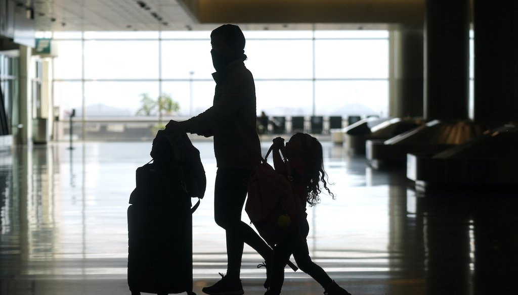 Travelers walk through the Salt Lake City International Airport on March 17, 2021, in Salt Lake City. (AP)