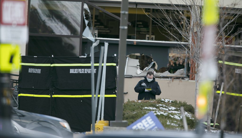 Police work on the scene outside of a King Soopers grocery store where authorities say multiple people were killed in a shooting on March 22, 2021, in Boulder, Colo. (AP)