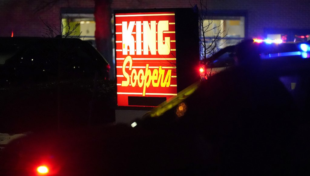 Police stand guard outside a King Soopers grocery store after a shooting, on March 22, 2021, in Boulder, Colo. (AP/Zalubowski)