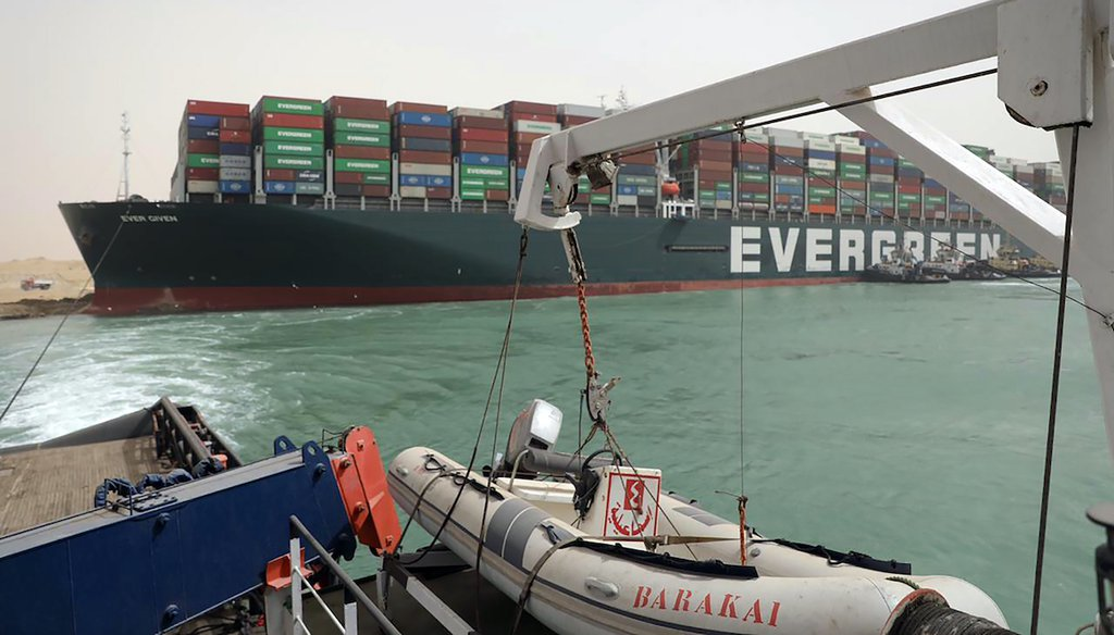 This photo released by the Suez Canal Authority on March 25, 2021, shows the Ever Given, a Panama-flagged cargo ship, after it become wedged across the Suez Canal and blocking traffic in the vital waterway. (Suez Canal Authority via AP)