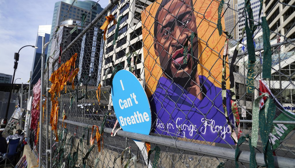 A picture of George Floyd hangs on a fence outside the Hennepin County Government Center on March 30, 2021, in Minneapolis during the trial for former Minneapolis police officer Derek Chauvin. (AP/Mone)