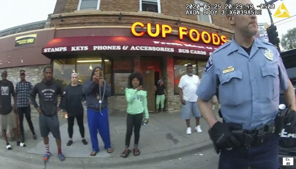 In this image, captured from police body camera video, former Minneapolis police Officer Derek Chauvin stands outside Cup Foods in Minneapolis, on May 25, 2020, with a crowd of onlookers behind him. (AP)