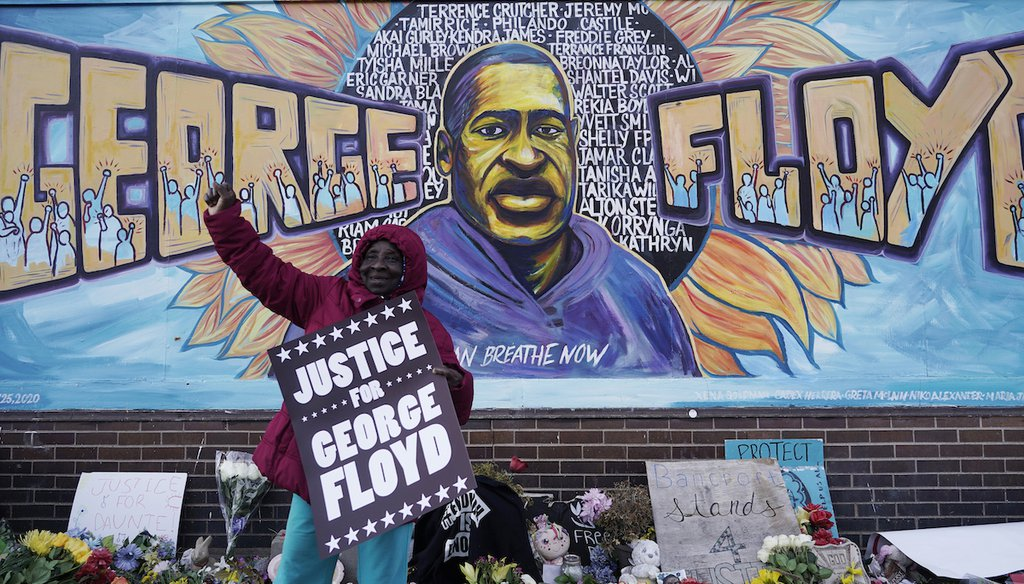 A person reacts in front of a mural near Cup Foods after a guilty verdict was announced at the trial of former Minneapolis police officer Derek Chauvin for the 2020 murder of George Floyd, on April 20, 2021, in Minneapolis. (AP/Gash)