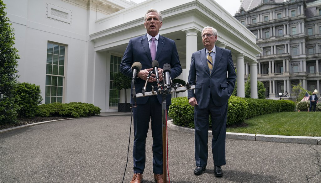 Senate Minority Leader Mitch McConnell of Ky., listens as House Minority Leader Kevin McCarthy of Calif., talks to reporters outside the White House, May 12, 2021. (AP)