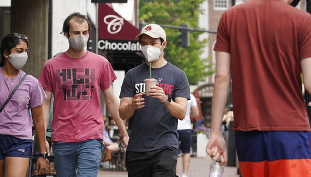 Pedestrians wear masks in Harvard Square in Cambridge, Mass., on May 23, 2021. (AP)