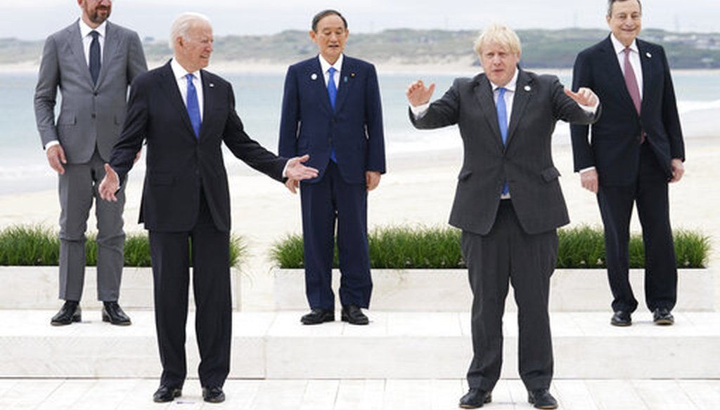 President Joe Biden, front left, and U.K. Prime Minister Boris Johnson, front right, with European Council President Charles Michel, back left, Japan's Prime Minister Yoshihide Suga, back center, and Italy's Prime Minister Mario Draghi.