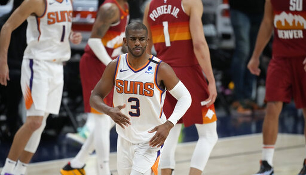 Phoenix Suns guard Chris Paul, front, in Game 4 of an NBA second-round playoff series against the Denver Nuggets on June 13, 2021. (AP)