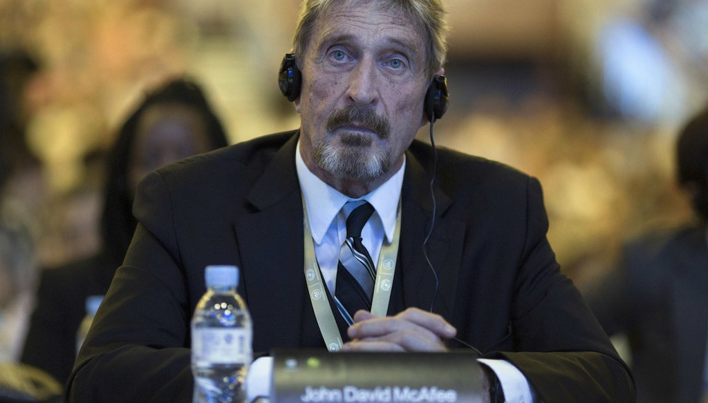 John McAfee, who developed the first commercial antivirus software for computers, appears at the 4th China Internet Security Conference in Beijing, in 2016. (AP)