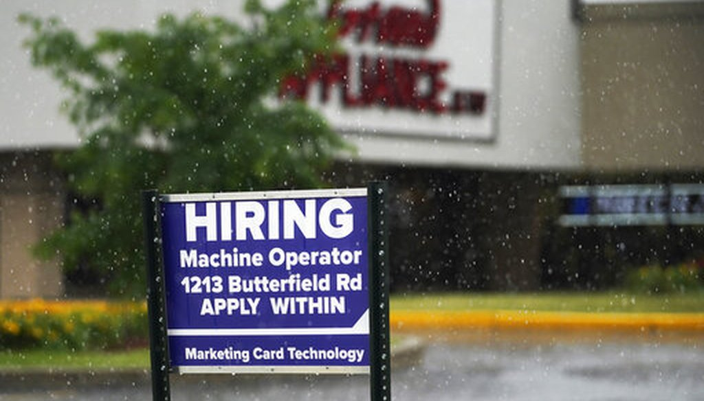 A hiring sign in Downers Grove, Ill. (AP)
