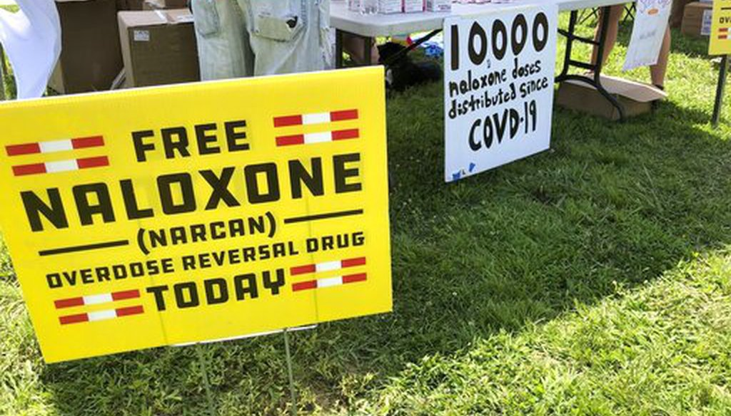 Volunteers pass out free doses of naloxone, a drug that reverses the effects of an opioid overdose, on June 26, 2021, in Charleston, W.Va. (AP)