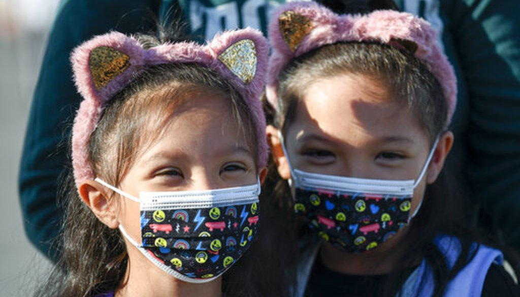 Masked students wait to go their classrooms on the first day of school at Enrique S. Camarena Elementary School Wednesday, July 21, 2021, in Chula Vista, Calif. (AP)