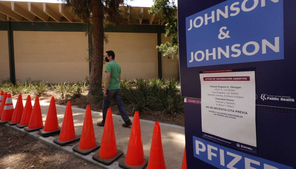 Carlos Arrendondo arrives for his appointment to get vaccinated, as banners advertise the availability of the Johnson & Johnson and Pfizer COVID-19 vaccines at a county-run vaccination site at the Eugene A. Obregon Park in Los Angeles, July 22, 2021. (AP)