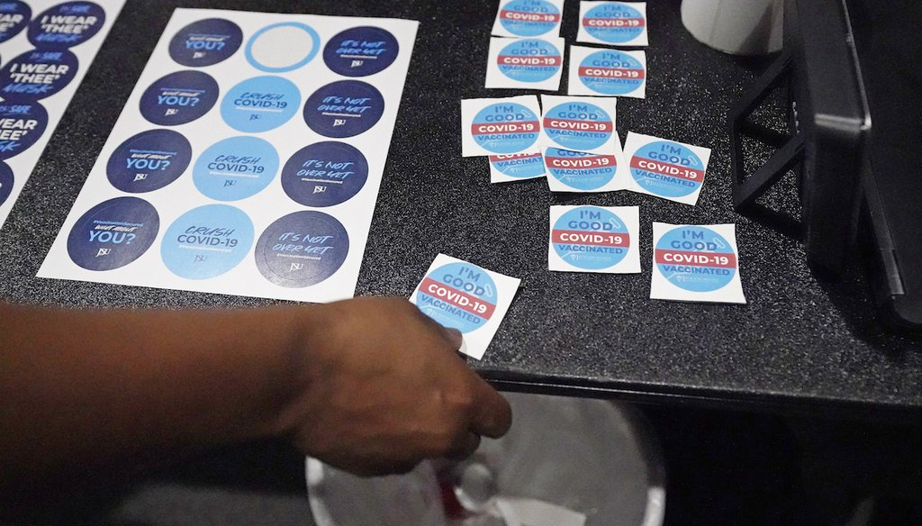 A student selects a sticker after receiving a shot of the COVID-19 vaccine at the Rose E. McCoy Auditorium at Jackson State University in Jackson, Miss., July 27, 2021. (AP)