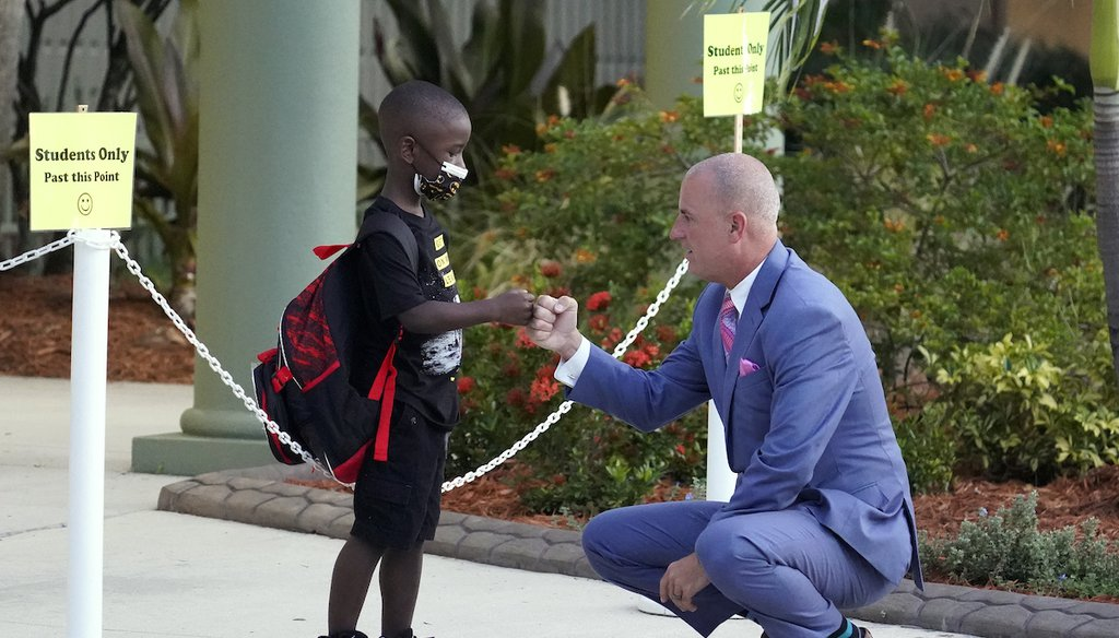 Addison Davis, Hillsborough County Superintendent of Schools, right, fist bumps student James Braden before he heads to class on the first day of school at Sessums Elementary School on Aug. 10, 2021, in Riverview, Fla. (AP)