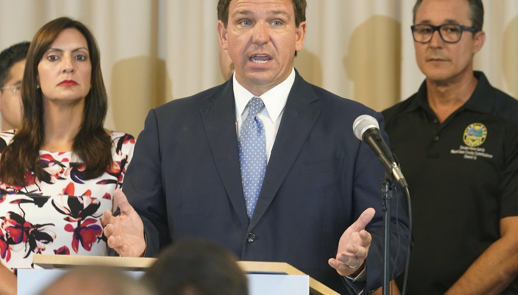Florida Gov. Ron DeSantis answers questions related to school openings and the wearing of masks, Tuesday, Aug. 10, 2021, in Surfside, Fla. (AP Photo/Marta Lavandier)