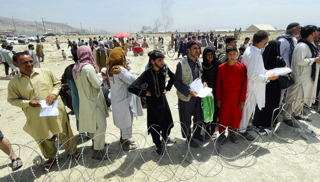 Hundreds of people gather outside the international airport in Kabul, Afghanistan, Aug. 17, 2021. (AP)