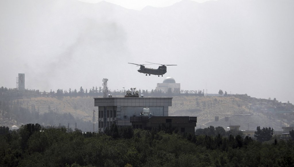 A U.S. Chinook helicopter flies over the U.S. Embassy in Kabul, Afghanistan, on Aug. 15, 2021. (AP/Gul)