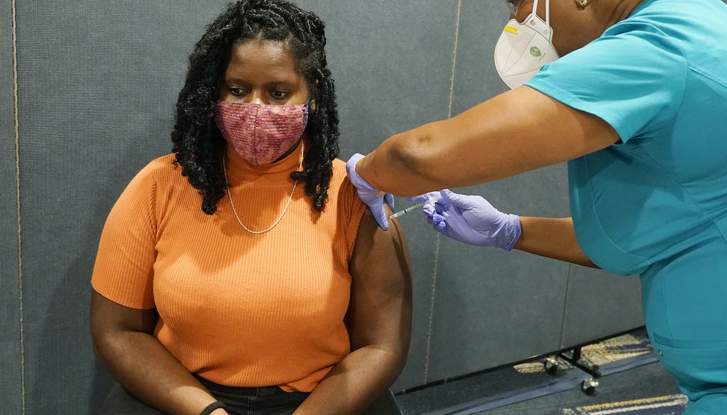 A nurse gives a Florida International University student a COVID-19 vaccine shot, Aug. 24, 2021. (AP)