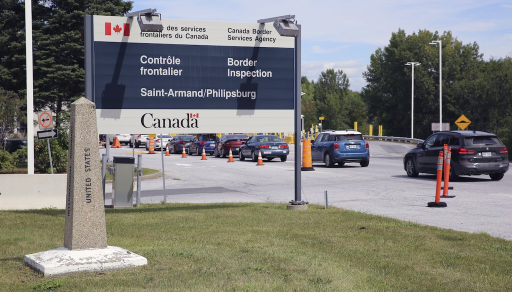 Cars pass a monument marking the border between the United States and Canada on Wednesday, Sept. 1, 2021, at Highgate Springs, Vt.  (AP)
