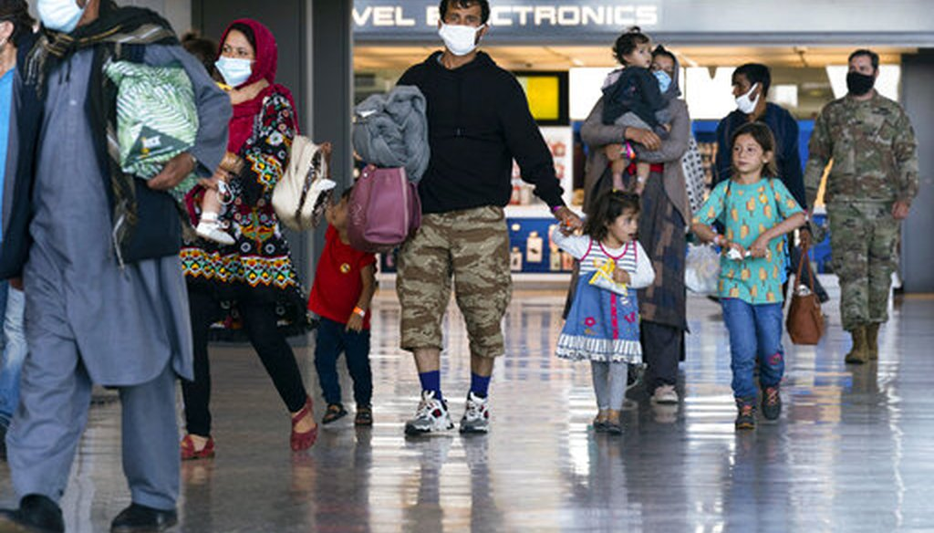 Families evacuated from Kabul, Afghanistan, walk through the terminal at Washington Dulles International Airport on Sept. 3, 2021. (AP)