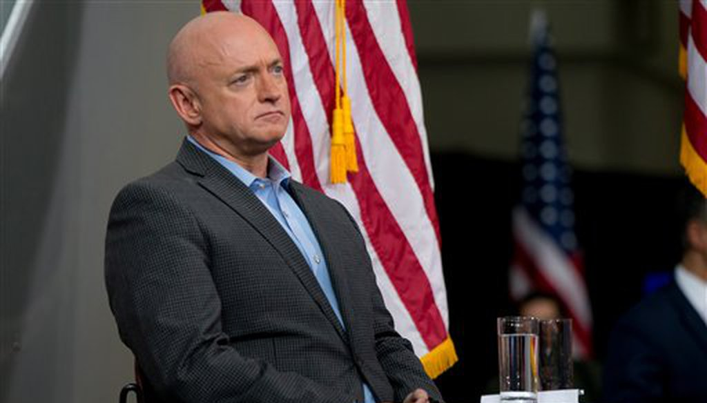 Astronaut Mark Kelly sits on stage as Democratic presidential candidate Hillary Clinton holds a rally at Iowa State University in Ames, Iowa, Jan. 30, 2016. (AP/Andrew Harnik)