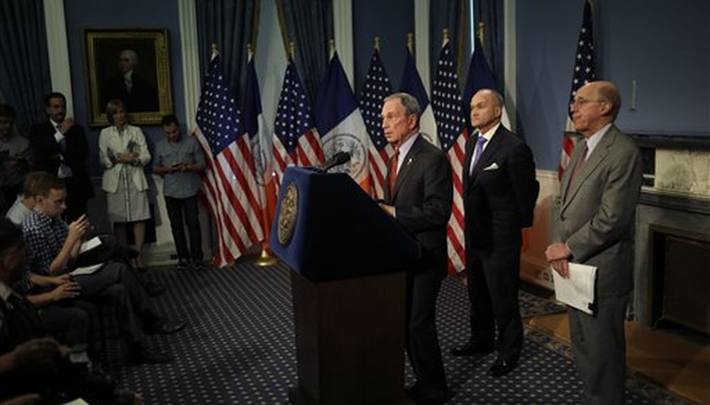 New York City Mayor Michael Bloomberg, left, speaks while Police Commissioner Ray Kelly, center, and attorney Michael Cardozo look on during a news conference in New York, Aug. 12, 2013. (AP/Seth Wenig)