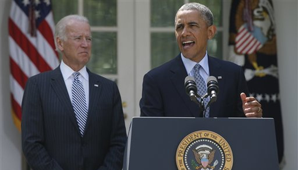 President Barack Obama stands with Vice President Joe Biden as he speaks about immigration in the Rose Garden at the White House, June 30, 2014. (AP/Charles Dharapak)