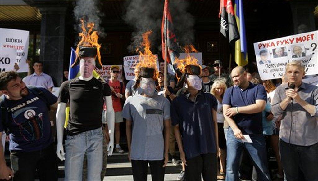Anti-corruption activists protest the Prosecutor General of Ukraine Viktor Shokin in Kiev, July 24, 2015. (AP)