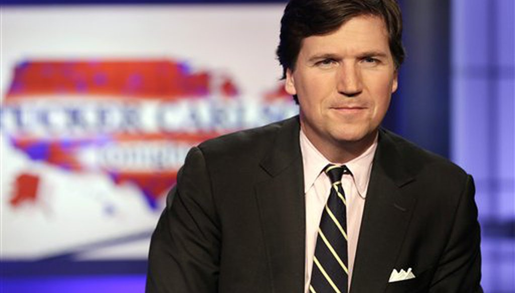Tucker Carlson poses for photos in a Fox News Channel studio in New York on March 2, 2017. (AP/Drew)