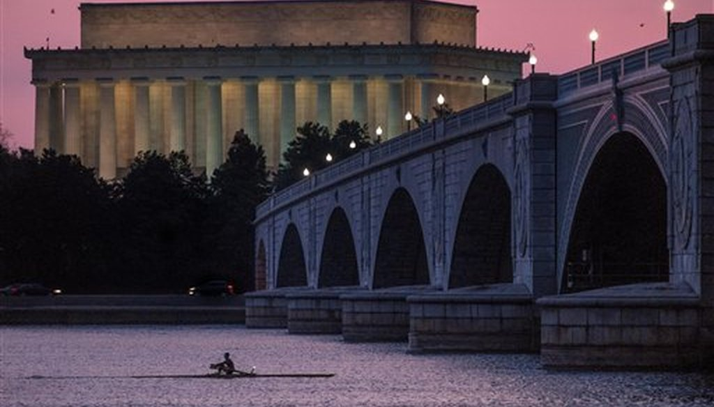 A rower moves along the Potomac River near the Lincoln Memorial in Washington, D.C., on March 21, 2014. (AP/Ake)