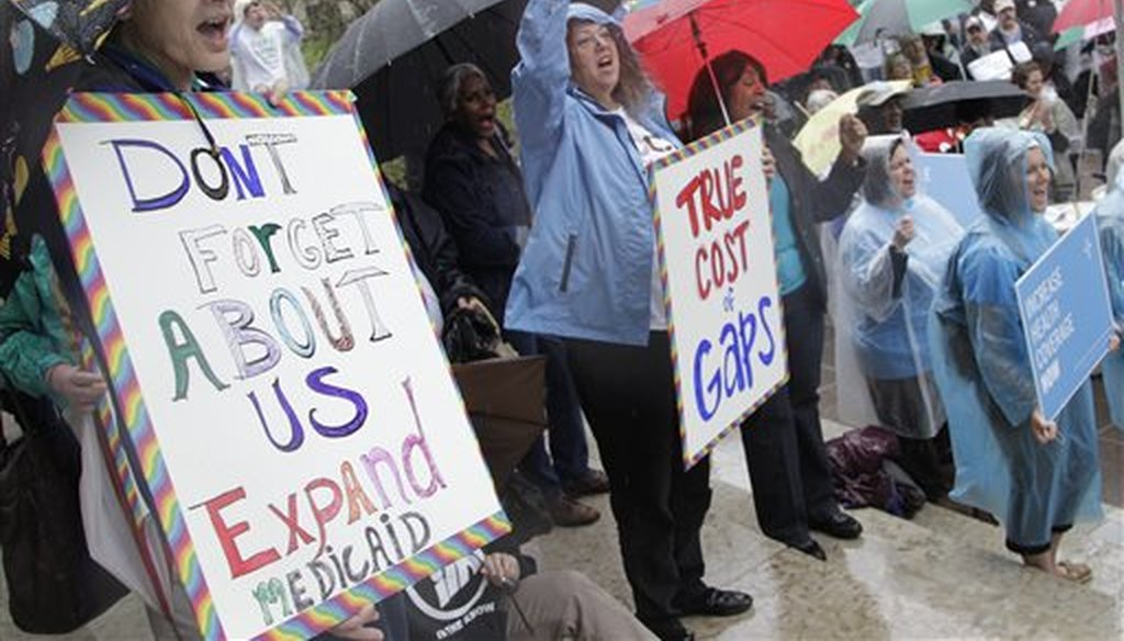 Demonstrators support for Medicaid extension outside the Ohio Statehouse during a rally on Thursday, April 11, 2013, in Columbus, Ohio. (AP/Jay LaPrete)