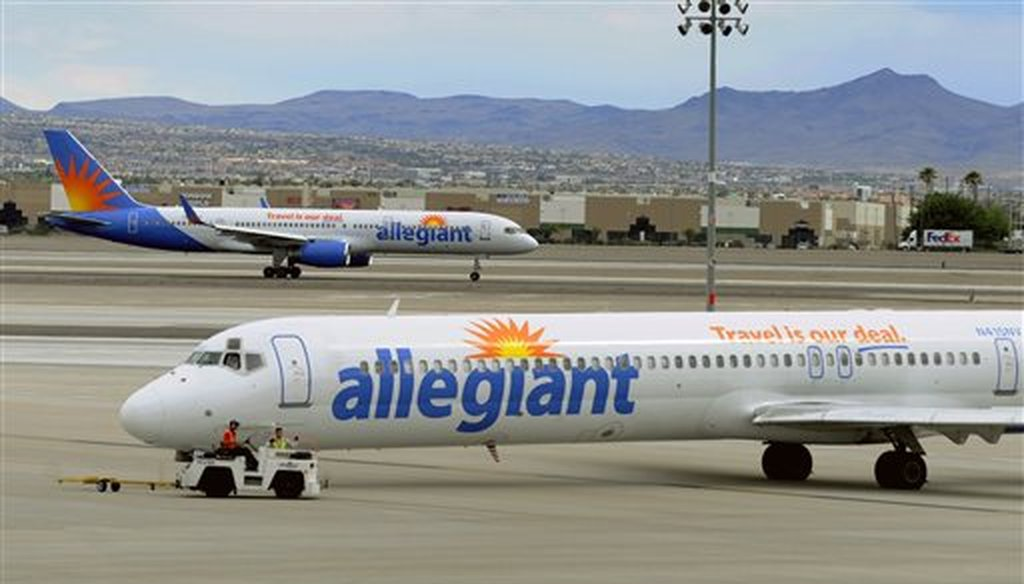 Two Allegiant Air jets taxi at McCarran International Airport in Las Vegas on May 9, 2013.  (AP Photo/David Becker, File)