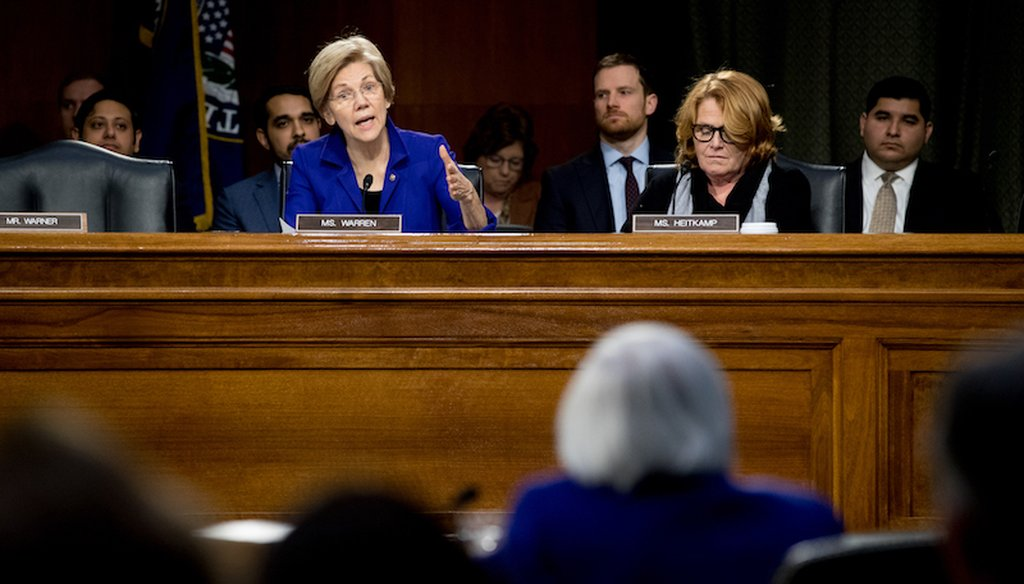 Sen. Elizabeth Warren, D-Mass., and Sen. Heidi Heitkamp, D-N.D., question Federal Reserve Chair Janet Yellen during a Senate Banking Committee hearing on Feb. 14, 2017.