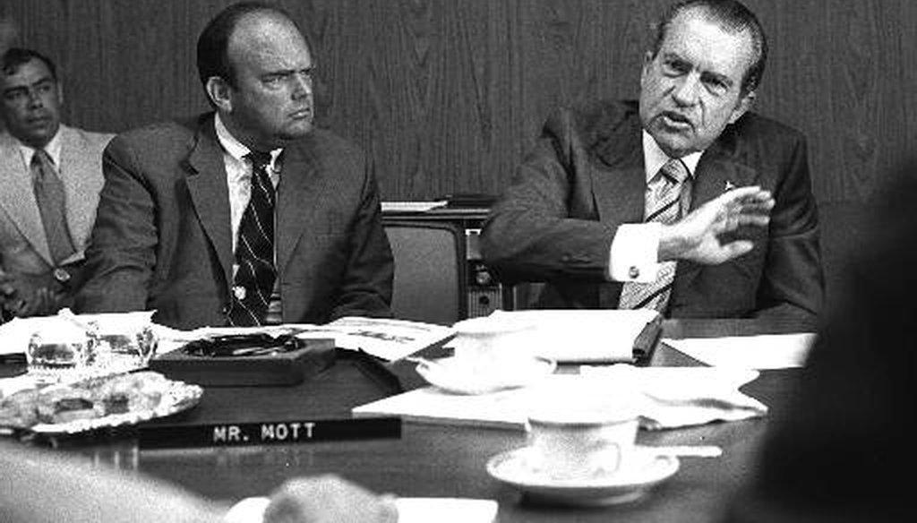 President Richard Nixon, right, discusses a California state park in 1972 as John D. Ehrlichman, Nixon's domestic affairs adviser, listens. (AP)