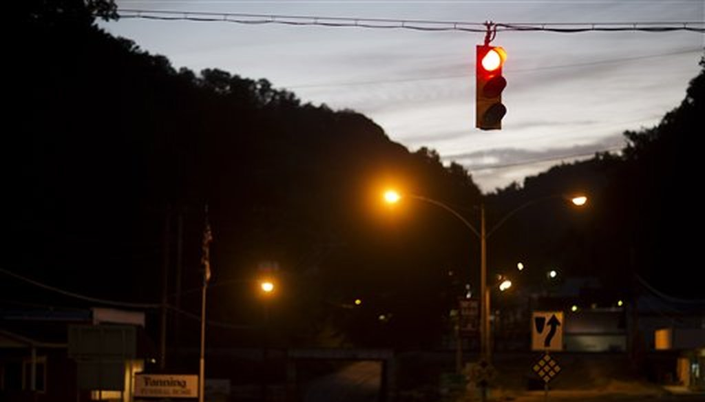 The only traffic light in McDowell County hangs over an intersection in Welch, W.Va., in 2015. (AP)