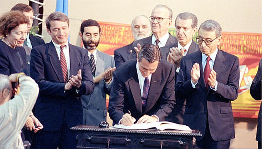 Brazil's then-President Fernando Collor de Mello signs the framework convention on climate change at the United Nations Conference on Environment and Development in Rio de Janeiro in 1992. (AP)