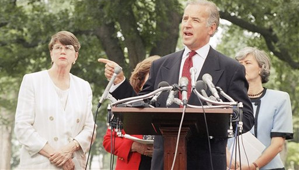 Then-Sen. Joseph Biden, D-Del., flanked by Attorney General Janet Reno, left, and Rep. Patricia Schroeder, D-Colo., promotes the Violence Against Women Act on July 19, 1994, prior to its passage that year. (AP)